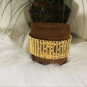 Gold colored bracelet with rhinestones